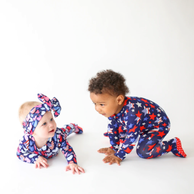 two kids in patriotic one piece baby clothes