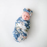 Swaddle-your-baby-soft-organic-bamboo-fibers-keep-baby-dry-and-comfy in blue rose