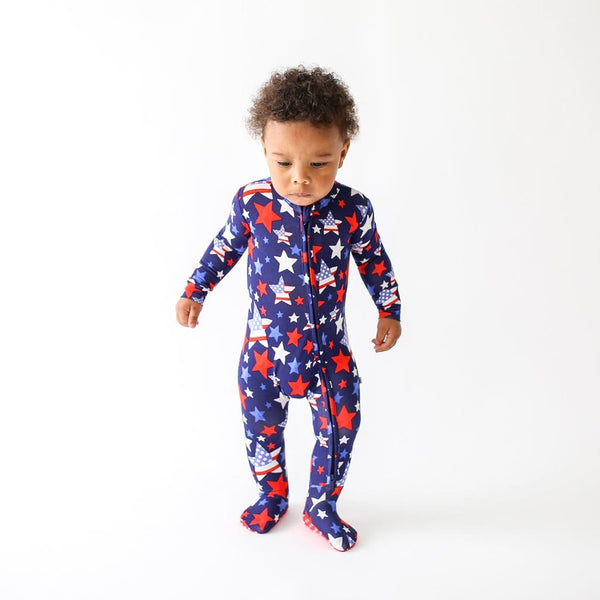 Toddler wearing Washington footie zippered one piece