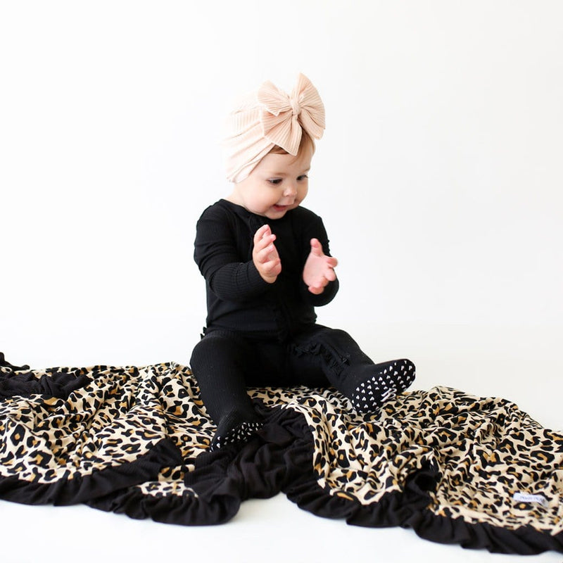 Baby sitting on Lana Leopard Tan & Black Ribbed Ruffled Luxe Patoo