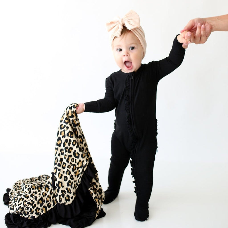 Cute baby holding Lana Leopard Tan & Black Ribbed Ruffled Luxe Patoo