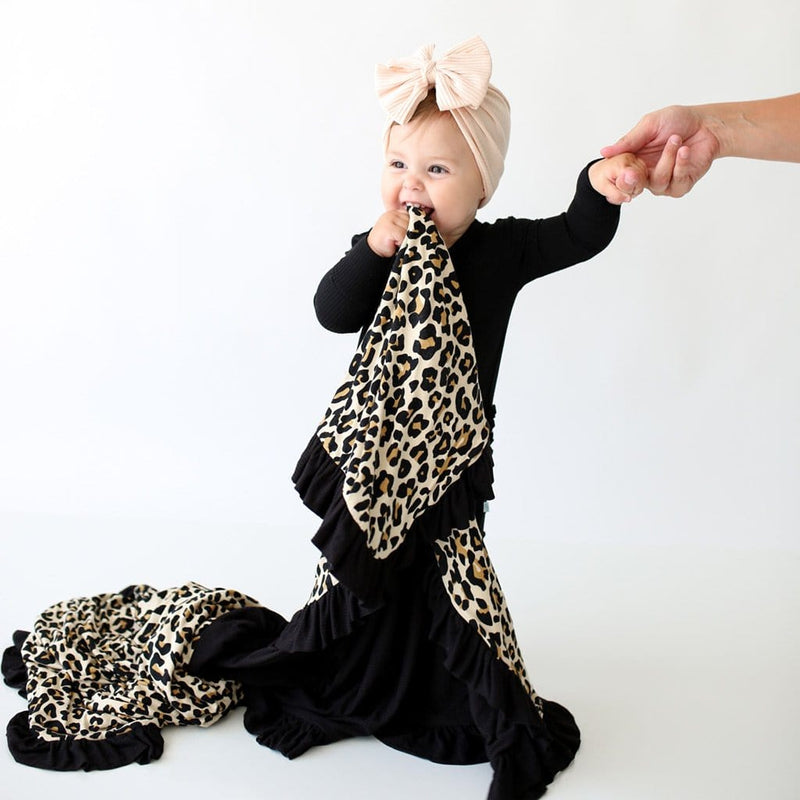 Baby holding Lana Leopard Tan & Black Ribbed Ruffled Luxe Patoo