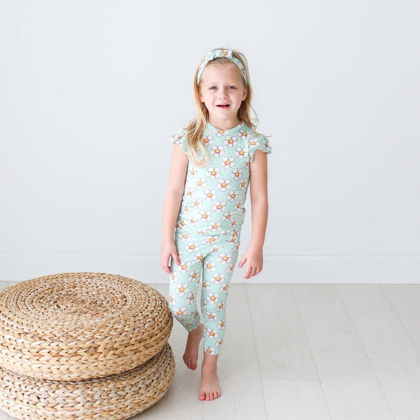 Toddler wearing Audrey ruffled cap sleeve pajamas