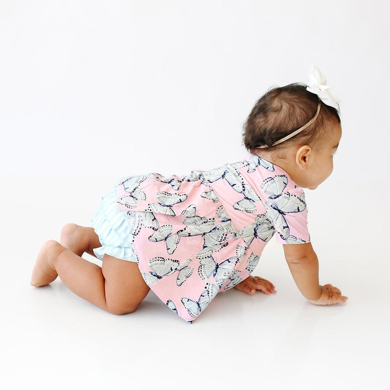 Baby crawling wearing Beatrice Short Sleeve Peplum Ruffled Bummie Set with butterfly pattern