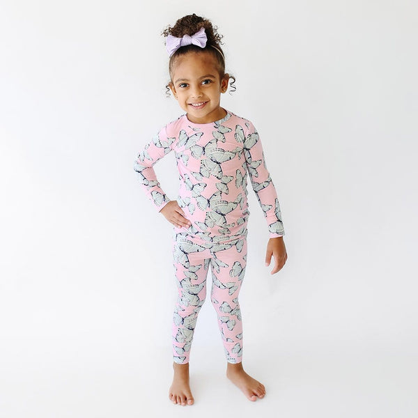 Toddler wearing Beatrice Long Sleeve Pajamas with butterfly pattern