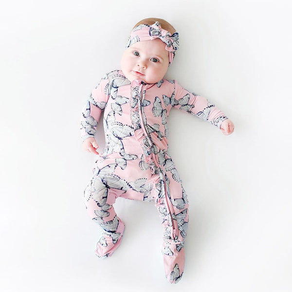 Baby wearing Beatrice Footie Ruffled Zippered One Piece with butterfly pattern