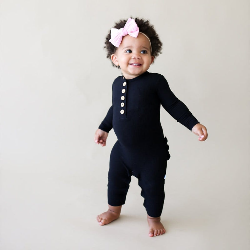 Black Ribbed Long Sleeve Ruffled Henley Romper worn by baby