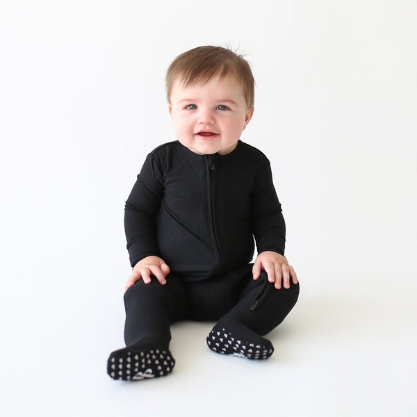 Baby wearing Black Ribbed Footie Zippered One Piece