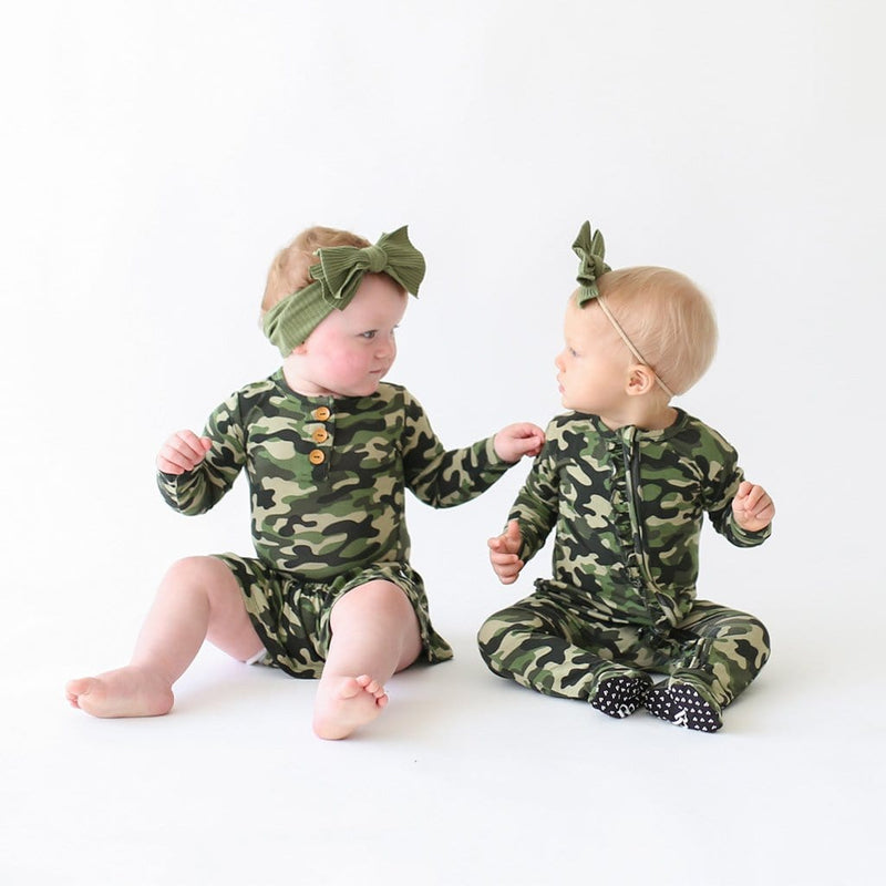 Sitting babies wearing Cadet collection