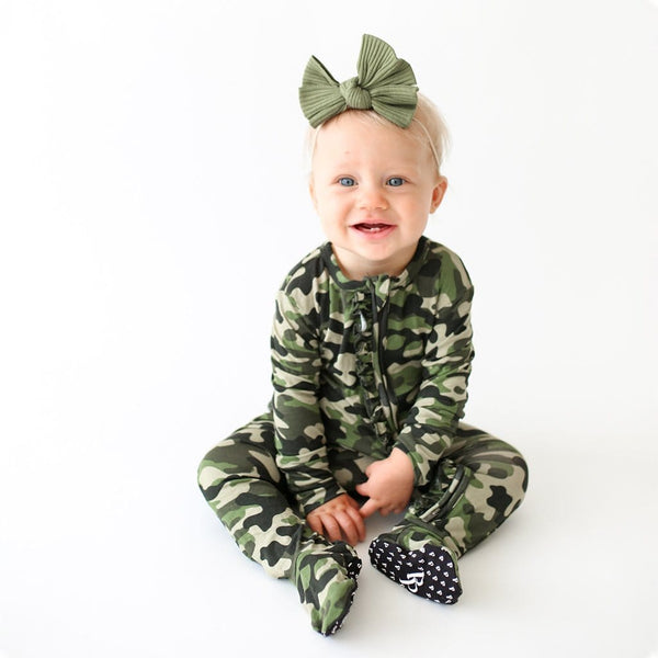 Baby with headwrap wearing Cadet Footie Ruffled Zippered One Piece