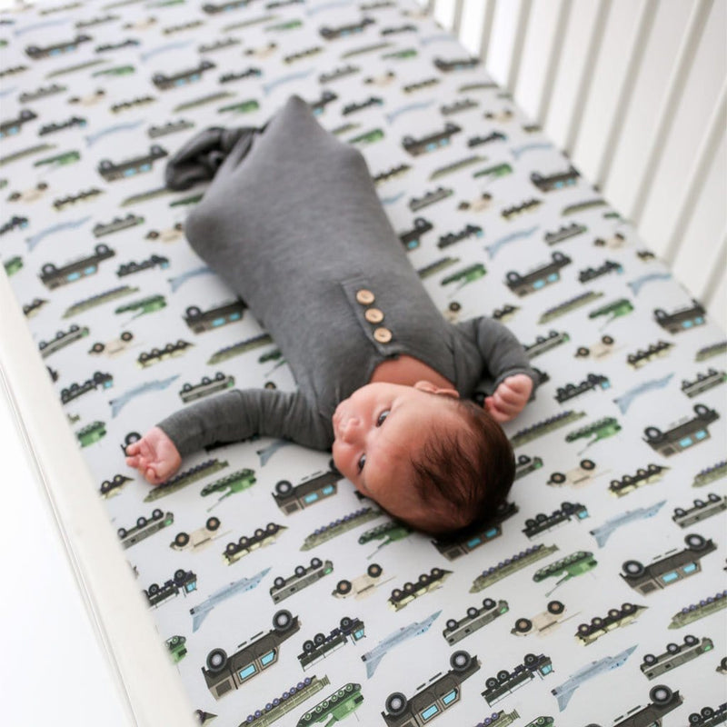 Baby lying on Cash Crib Sheet