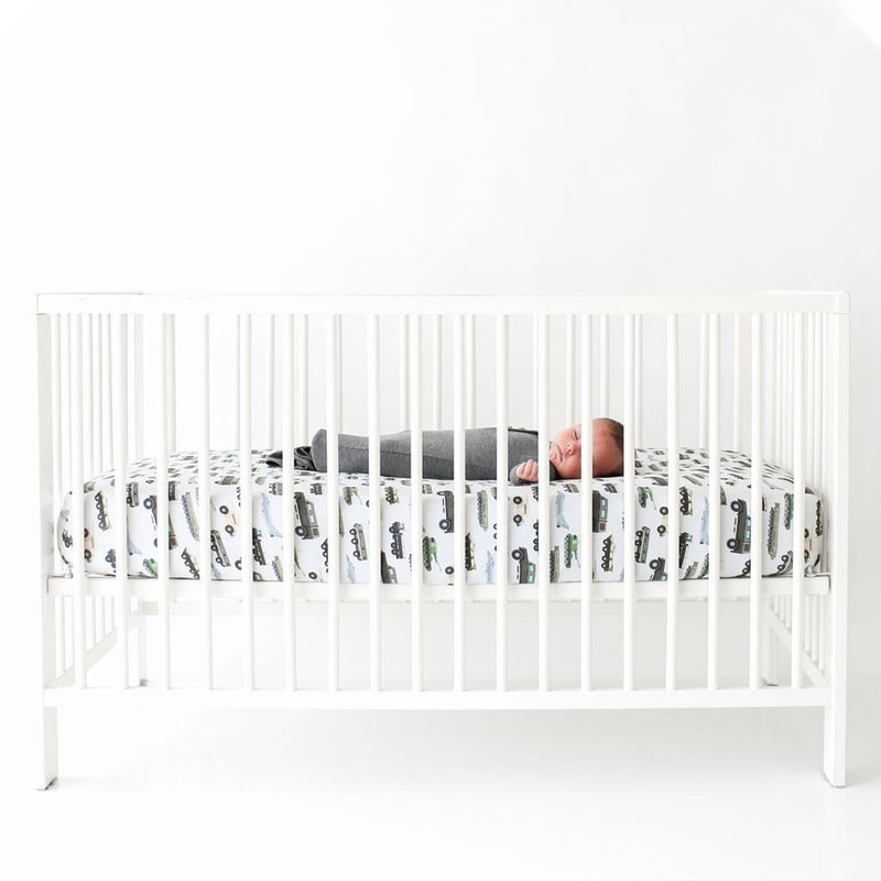 Cash Crib Sheet on white crib
