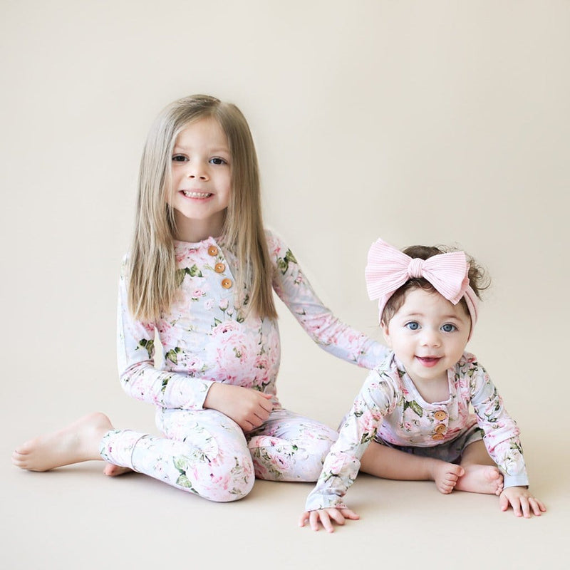 Toddler with sister wearing Celine long sleeve henley pajamas