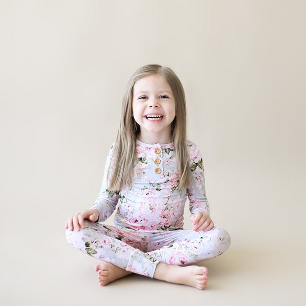 Toddler wearing Celine long sleeve henley pajamas
