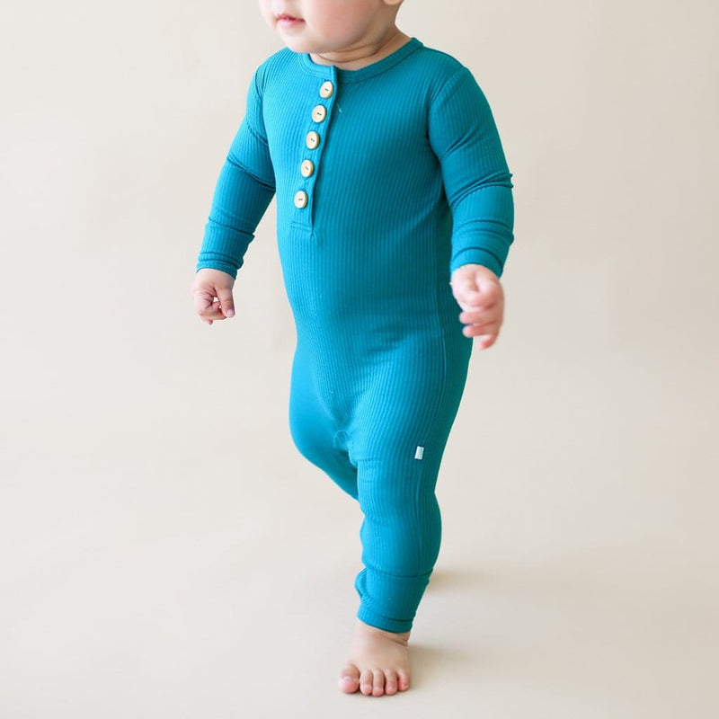 Walking baby on Cerulean Ribbed Long Sleeve Henley Romper