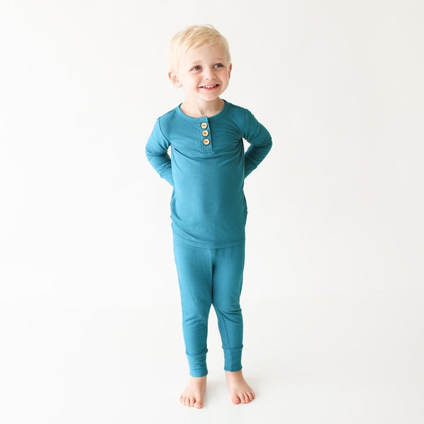 Toddler wearing Cerulean ribbed long sleeve henley pajamas