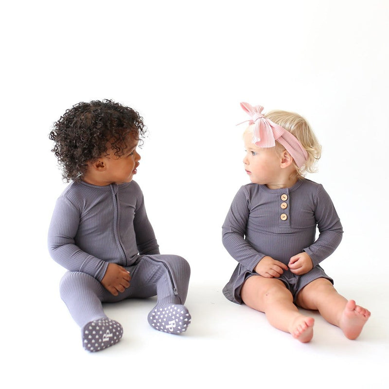 Babies wearing Charcoal Collection Clothing