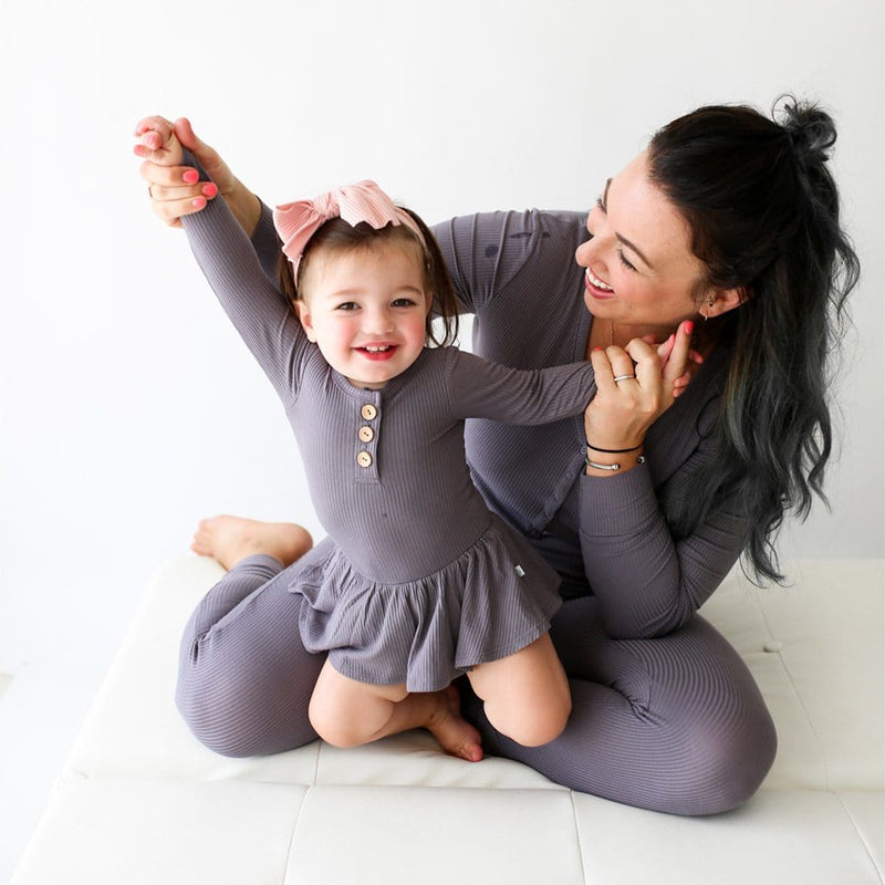 Mommy cuddling baby wearing Charcoal Ribbed Long Sleeve Henley Twirl Skirt Bodysuit