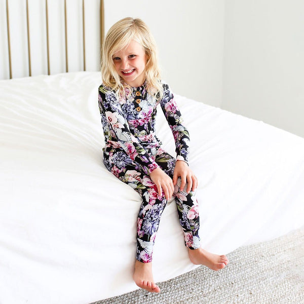 Toddler on bed wearing Chelsea Long Sleeve Henley Pajamas