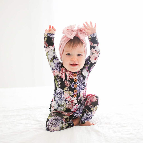 Sitting baby wearing Chelsea Long Sleeve Ruffled Henley Romper