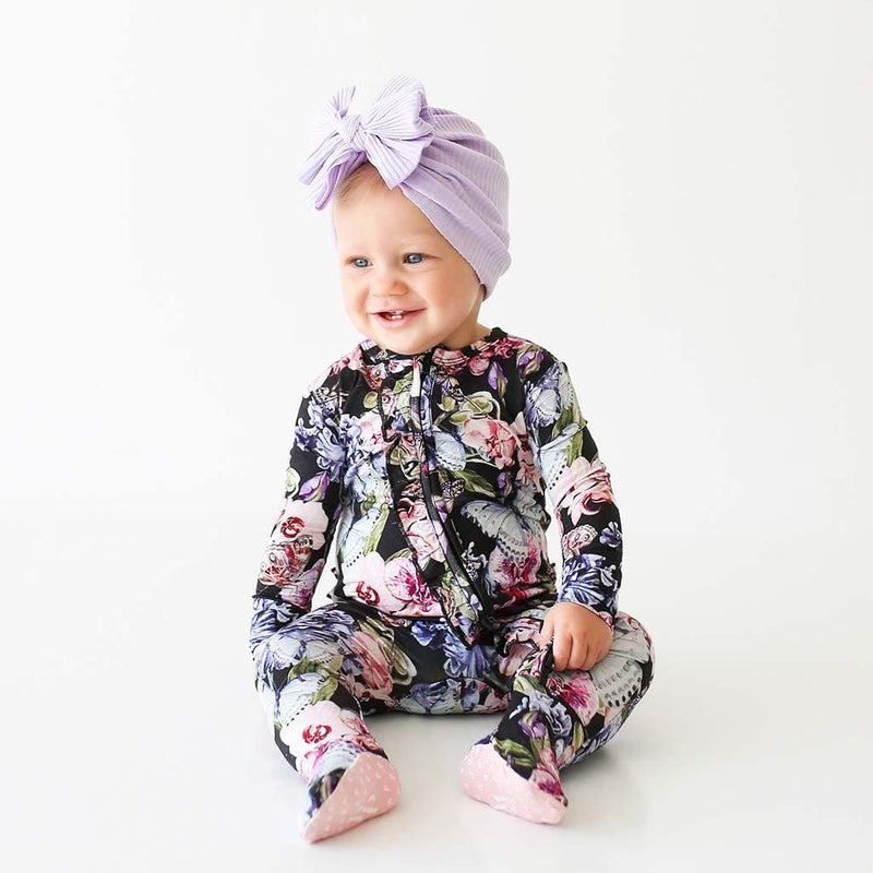 Baby wearing Chelsea Footie Ruffled Zippered One Piece