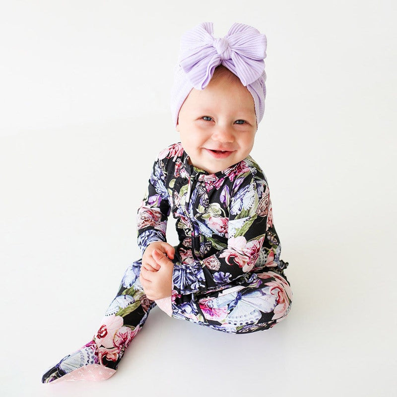 Smiling baby wearing Chelsea Footie Ruffled Zippered One Piece