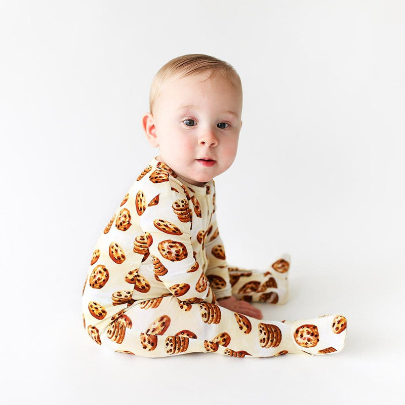 Baby wearing Chip Footie Zippered One Piece with cookie pattern