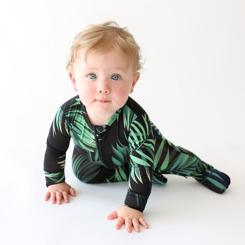 Baby on Cooper Footie Zippered One Piece with leaf design