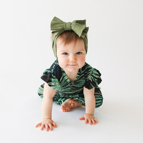 Baby on Cooper Ruffled Cap Sleeve Romper with leaf design