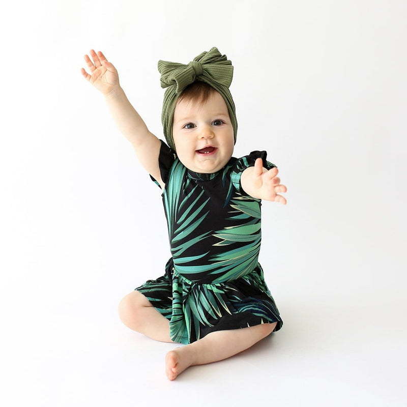 Baby wearing Cooper Ruffled Cap Sleeve Twirl Skirt Bodysuit
