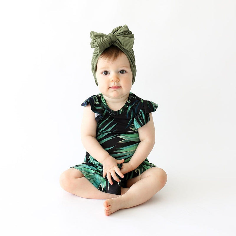 Cute baby wearing Cooper Ruffled Cap Sleeve Twirl Skirt Bodysuit with leaf design