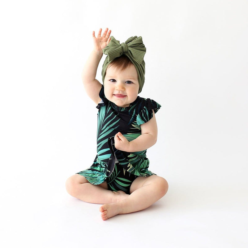 Sitting baby on Cooper Ruffled Cap Sleeve Twirl Skirt Bodysuit with leaf design