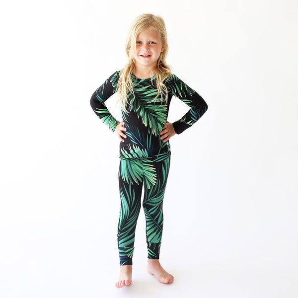 Toddler wearing Cooper Long Sleeve Pajamas with leaf design