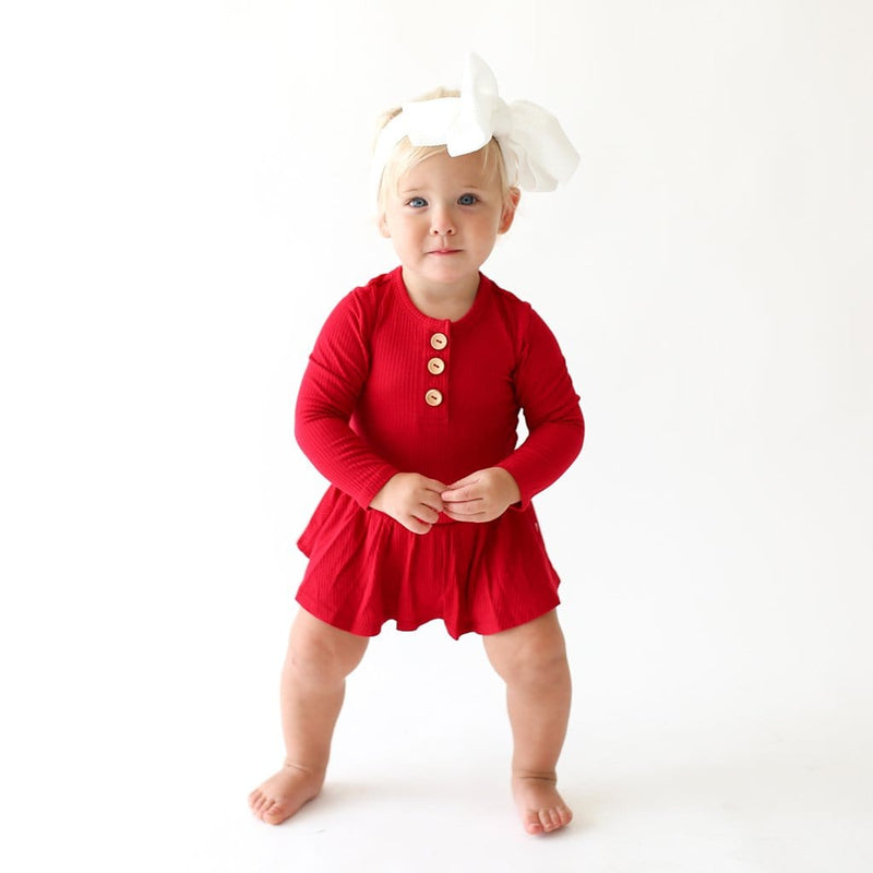 Standing baby wearing Crimson Ribbed Long Sleeve Henley Twirl Skirt Bodysuit