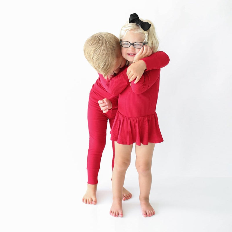 Kid hugging his sister wearing Crimson Ribbed Long Sleeve Henley Twirl Skirt Bodysuit