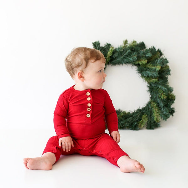 Sitting baby wearing Crimson Ribbed Long Sleeve Henley Romper