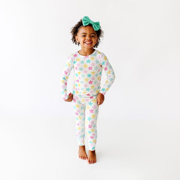 Toddler wearing Crissy Long Sleeve Pajamas with star pattern