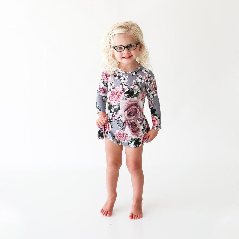 Toddler on glasses wearing Daphne Long Sleeve Twirl Skirt Bodysuit