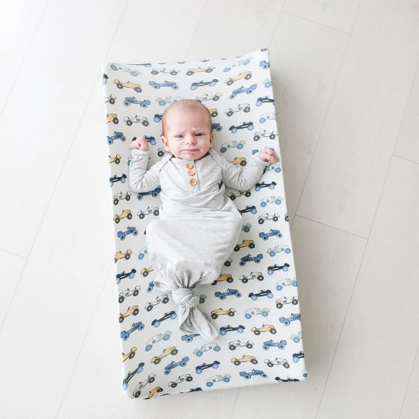 Baby lying on Enzo pad cover
