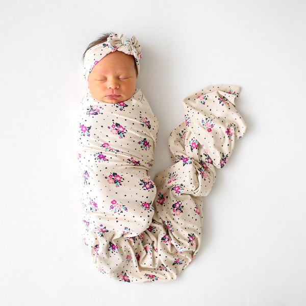 Baby wearing Frances swaddle headband set