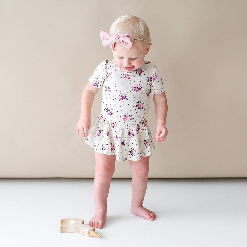 Baby wearing Frances short sleeve twirl skirt bodysuit