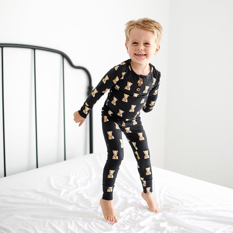 Jumping Toddler wearing Fred Long Sleeve Henley Pajamas