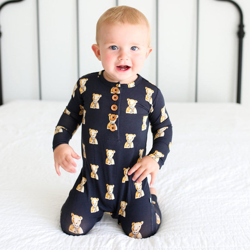 Baby on bed wearing Fred Long Sleeve Henley Romper