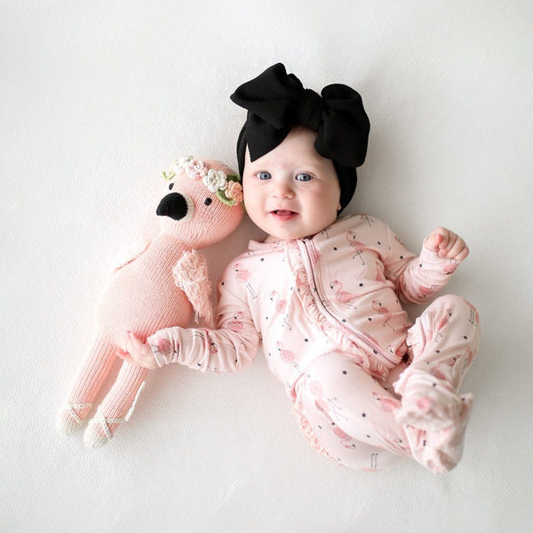 Baby lying on Frida footie ruffled zippered one piece