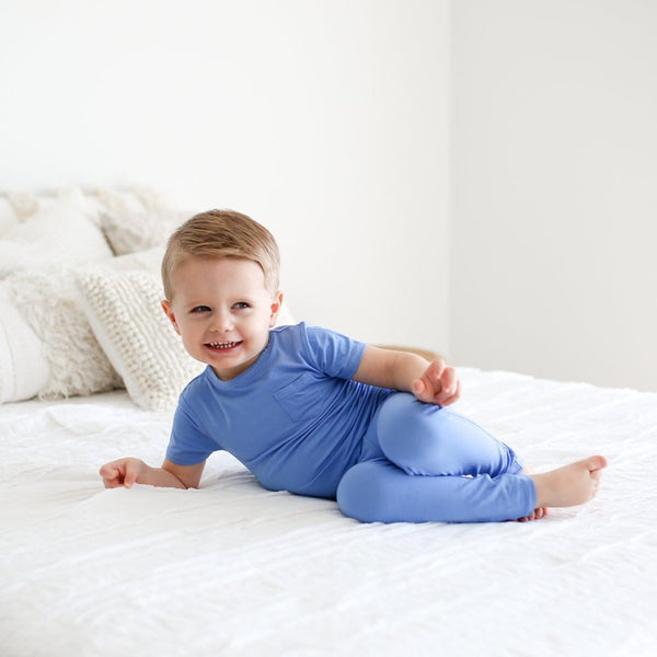 Toddler wearing granada sky short sleeve pajamas