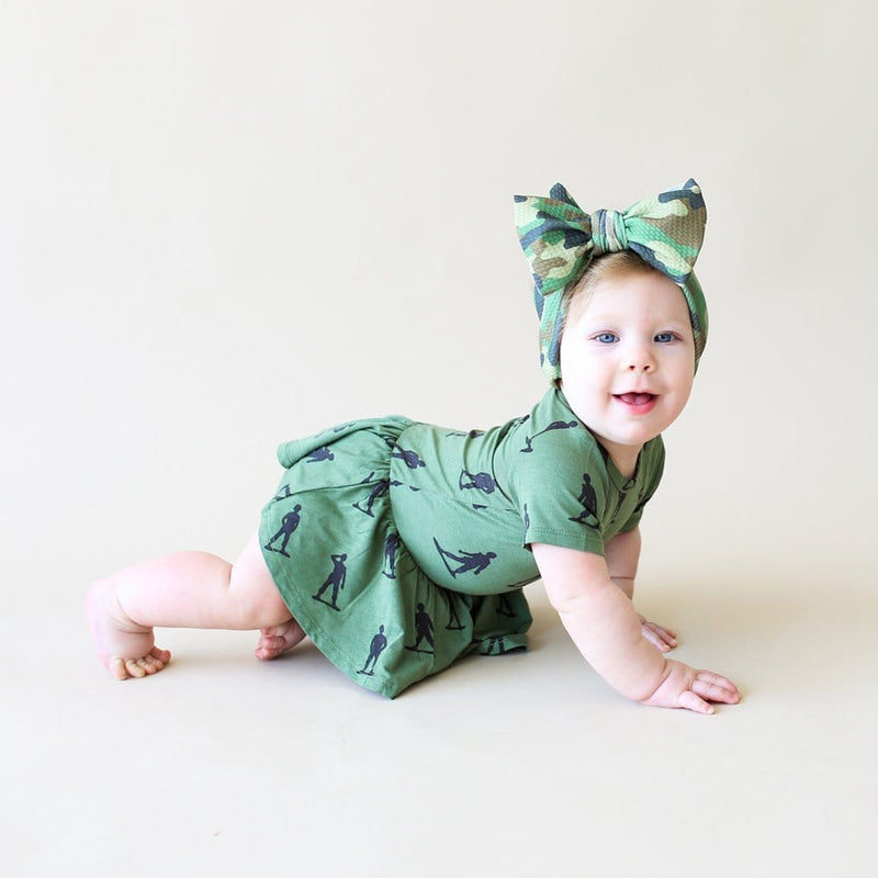 Baby crawling wearing James short sleeve twirl skirt bodysuit