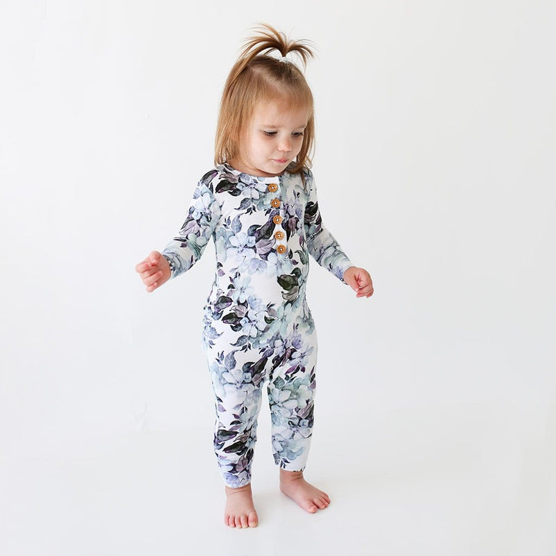Girl kid wearing Jules Floral Long Sleeve Ruffled Henley Romper