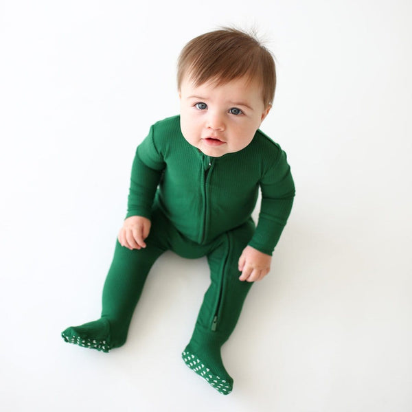 Sitting baby wearing Juniper Green Ribbed Footie Zippered One Piece