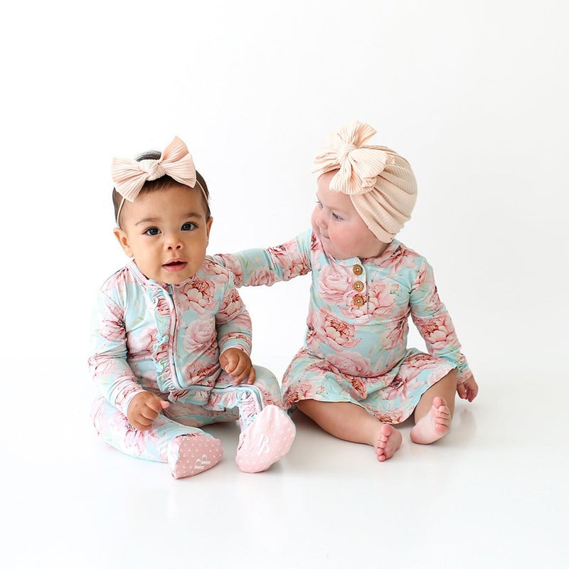 Babies with matching Kennedy style clothes