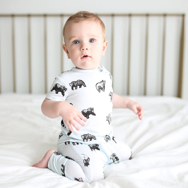 Baby on bed wearing Kodiak short sleeve romper